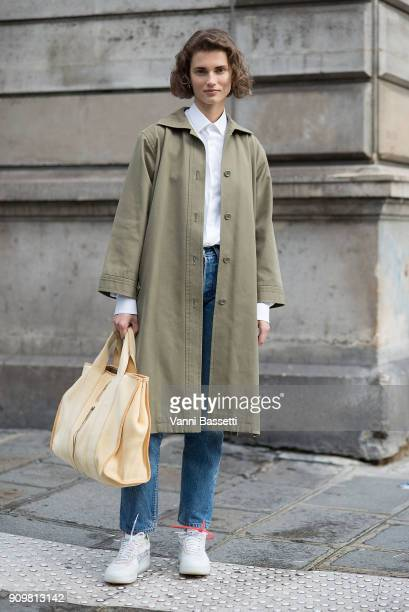 A model poses wearing Off White x Nike shoes after the Acne Studios show during Paris Fashion Week Haute Couture Spring Summer 2018 on January 24...