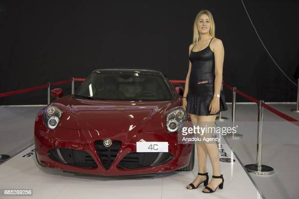 A model poses with a Alfa Romeo 4C during the Naples Motor Show 2017 at Mostra d Oltremare in Naples Italy on May 19 2017