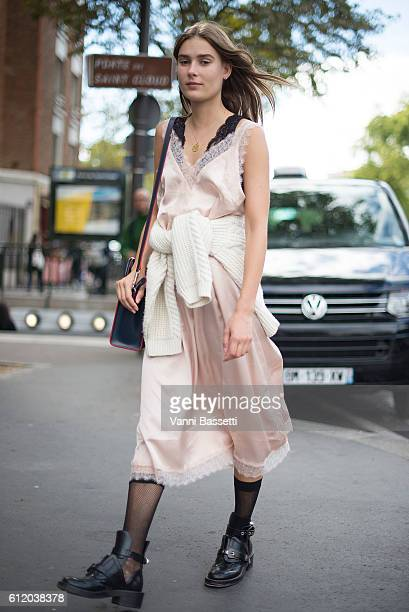 A model poses with a Celine bag after the Celine show at the Tennis Club de Paris during Paris Fashion Week Womenswear SS17 on October 2 2016 in...