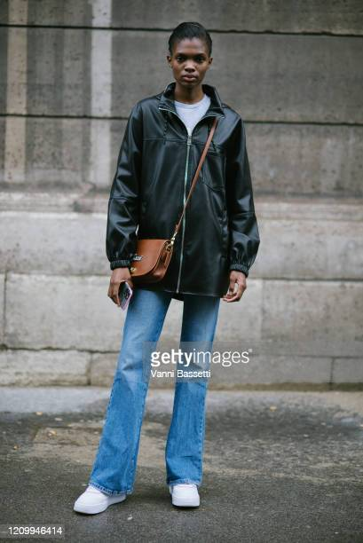 Model poses with a Coach bag after the Giambattista Valli show at the Musée des Arts Décoratifs during Paris Fashion Week Womenswear Fall/Winter...