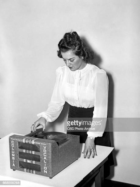 A model poses with a Columbia Records / Vocalion record player Vocalion is a subsidiary of Columbia Records in Bridgeport CT Image dated April 1 1940...