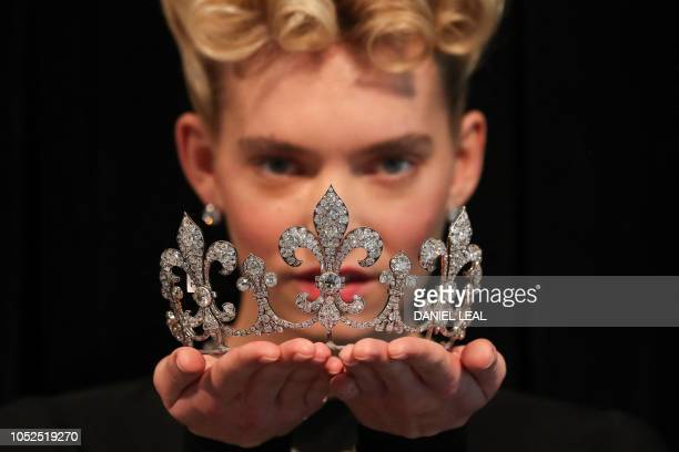 A model poses with a Diamond Tiara 'Hubner' circa 1912 with an estimated value of £268000£42200 GBP during a photocall for the sale of 'Royal Jewels...