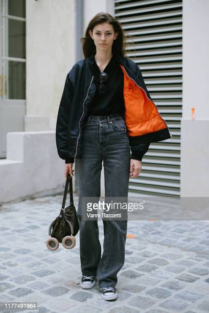 A model poses with a Fendi bag after the Olivier Theyskens show during Paris Fashion Week Womenswear Spring Summer 2020 on September 27 2019 in Paris...