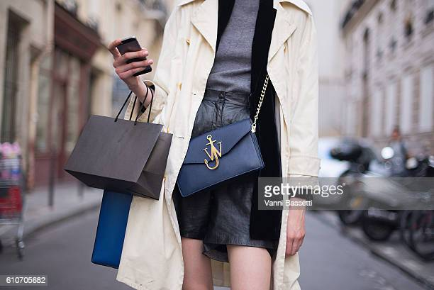 A model poses with a JW Anderson bag after the Olivier Theyskens show during Paris Fashion Week Womenswear SS17 on September 27 2016 in Paris France
