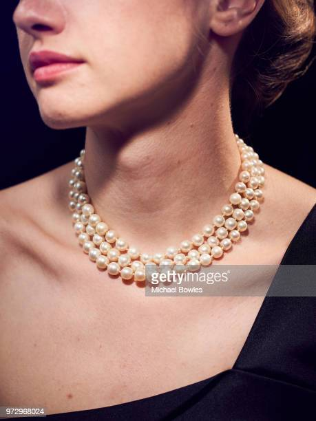 A model poses with a necklace featuring 331 natural pearls that belonged to MarieAntoinette Queen of France and will be auctioned in the 'Royal...