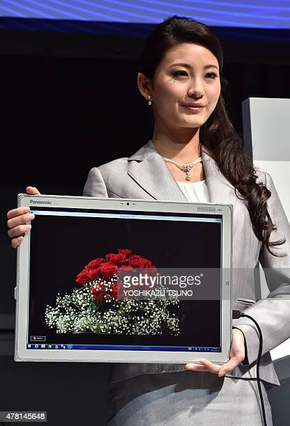 A model poses with a new large tablet called 'Toughpad 4K' by Japan's electronics giant Panasonic equipped with a 20inch sized high resolution 4K LCD...