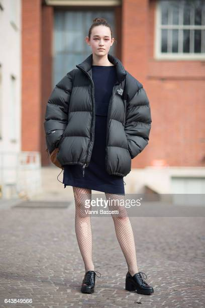 A model poses with a North Face down after the Wunderkind show during Milan Fashion Week Fall/Winter 2017/18 on February 22 2017 in Milan Italy