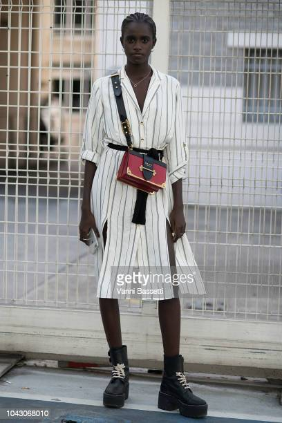 A model poses with a Prada bag after the Vivienne Westwood show at the Garage Amelot during Paris Fashion Week SS19 Womenswear on September 29 2018...