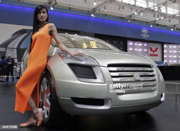 Model poses with General Motor Corp.'s hydrogen powered Sequel concept car at the 2005 Shanghai International Auto Show in Shanghai Thursday, April...