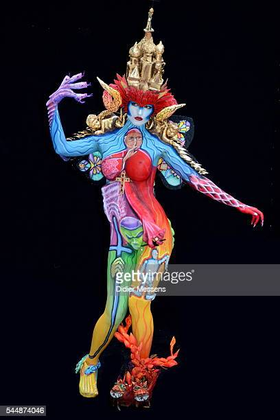 A model poses with her bodypainting designed by bodypainting artist Giovanna Patane from Italy during the World Bodypainting Festival on July 3 2016...