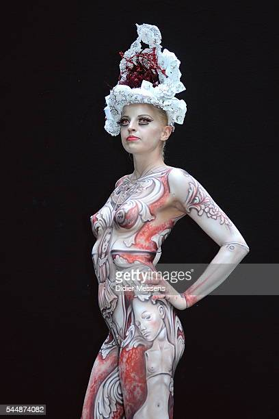 A model poses with her bodypainting designed by bodypainting artist Elisabeth Presslauer from Austria during the World Bodypainting Festival on July...