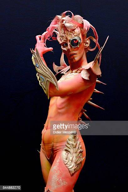A model poses with her bodypainting designed by bodypainting artist Heather Benson from Greece during the World Bodypainting Festival in Poertschach...