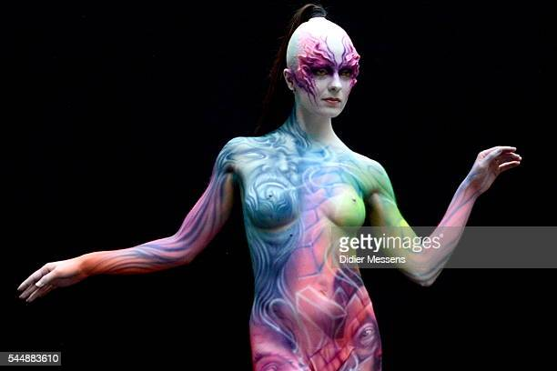 A model poses with her bodypainting designed by bodypainting artist Francesca Taraciotti from Italy during the World Bodypainting Festival in...