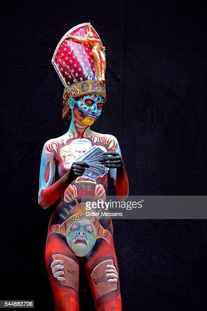 A model poses with her bodypainting designed by bodypainting artist Miguel Angel from Colombia during the World Bodypainting Festival in Poertschach...