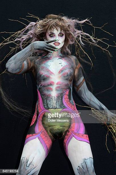 A model poses with her bodypainting designed by bodypainting artist Guenther Prucher from Germany during the World Bodypainting Festival in...