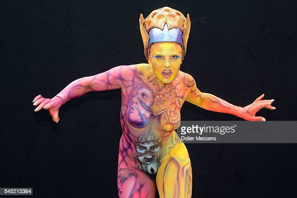 A model poses with her bodypainting designed by bodypainting artist Fernando Machado from Uruguay during the World Bodypainting Festival in...