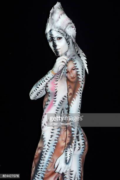 A model poses with her bodypainting designed by bodypainting artist Leonardo Giacome Borgese from Italy during the 20th World Bodypainting Festival...