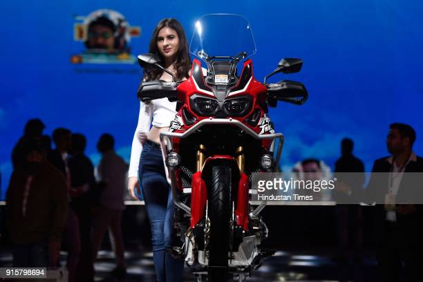 A model poses with Honda Africa Twin during Auto Expo Motor Show 2018 on February 8 in Greater Noida India
