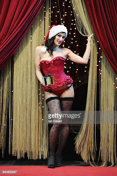 A model poses with mistletoe at the launch of Westfield's Adult Only Grown Up Grotto at Westfield Shopping Centre on December 15 2009 in London...