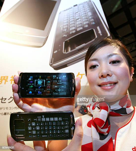 A model poses with NTT DoCoMo Inc's F04B mobile phones at an unveiling of the company's new mobile phone models in Tokyo Japan on Tuesday Nov 10 2009...