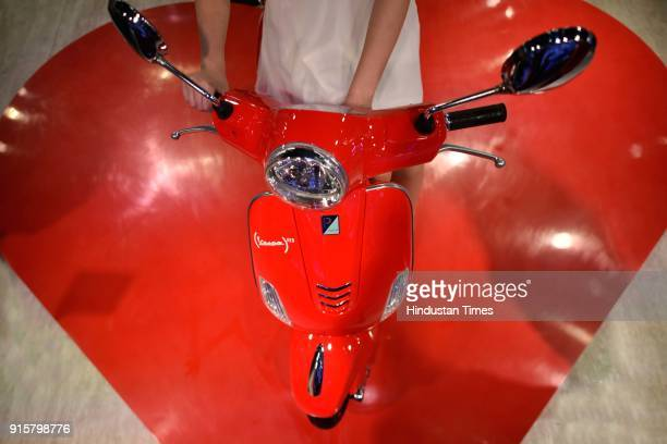 A model poses with Piaggio Vespa during Auto Expo Motor Show 2018 on February 8 in Greater Noida India