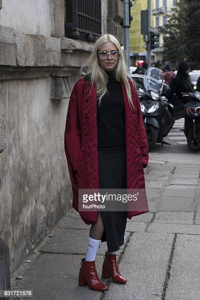 Model poses with red leather boots with with tennis socks and net tights is seen at Marni during Milan Men's Fashion Week Fall/Winter 2017/18 on...