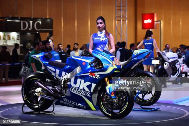 A model poses with Suzuki Ecstar during Auto Expo Motor Show 2018 on February 8 in Greater Noida India