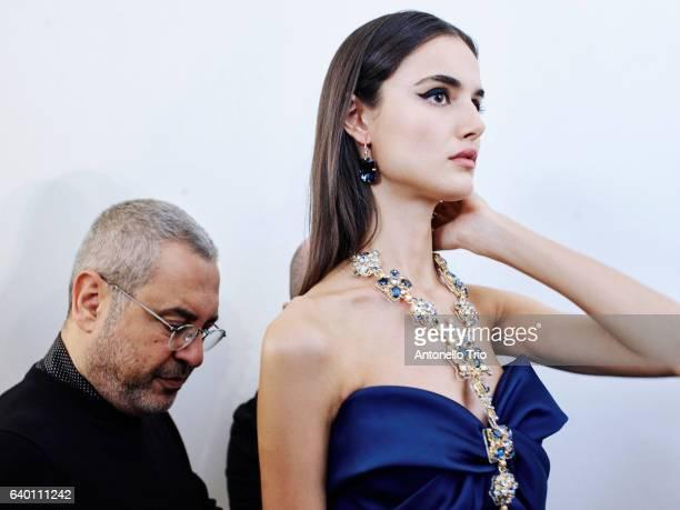 Model poses with the designer Elie Saab at Backstage prior the Elie Saab Fashion Week on January 25, 2017 in Paris, France.