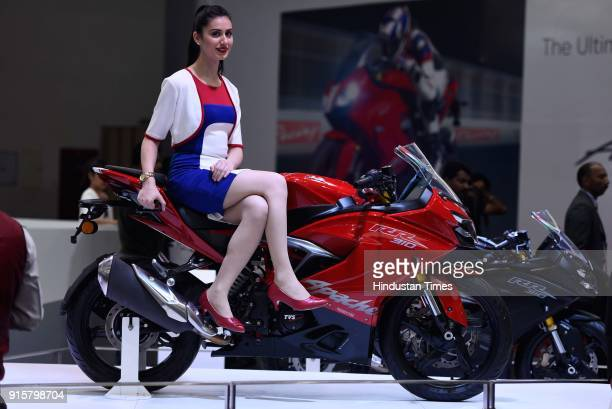A model poses with TVS Apace RR 310 during Auto Expo Motor Show 2018 on February 8 in Greater Noida India