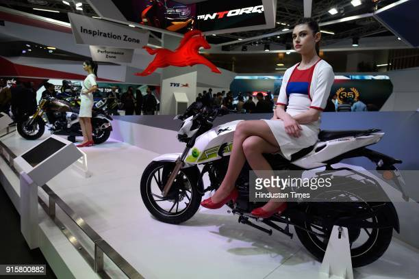 A model poses with TVS Apache Ethanol during Auto Expo Motor Show 2018 on February 8 in Greater Noida India