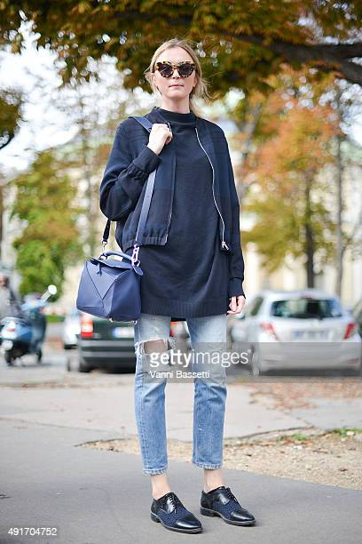 A model poses witha a Loewe bag after the Moncler Gamme Rouge show at the Grand Palais during Paris Fashion Week SS16 on October 7 2015 in Paris...