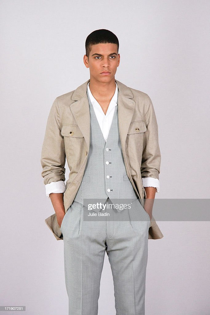 A model posing for a photographer before the Francesco Smalto Menswear Spring/Summer 2014 Show As Part Of The Paris Fashion Week on June 29, 2013 in Paris, France.