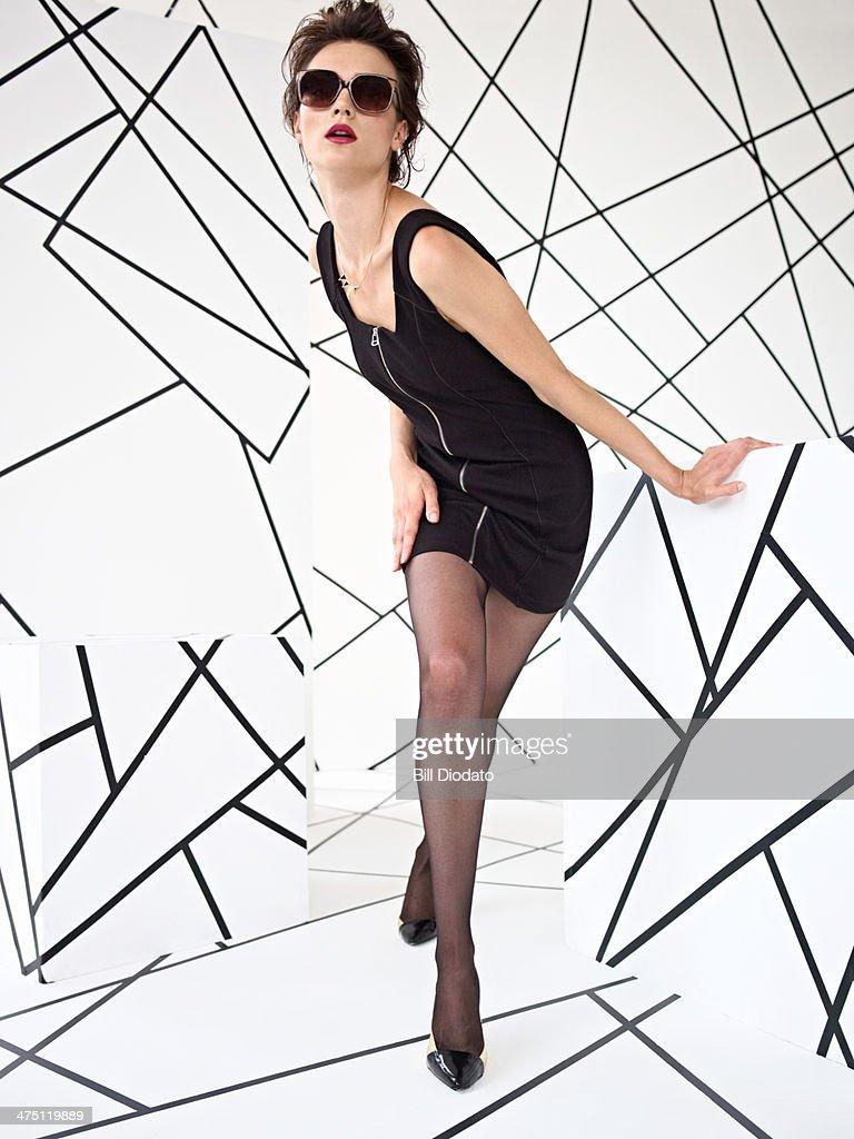 Model posing in black dress in studio