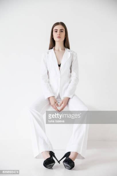 Model posing in elegant suit