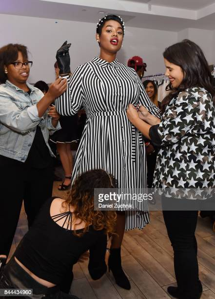 Model Precious Lee poses backstage during the DiaCo fashion show and industry panel at the CURVYcon at Metropolitan Pavilion West on September 8 2017...