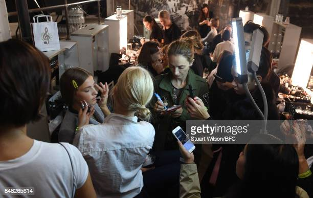 Model preparation backstage ahead of the Mary Katrantzou show during London Fashion Week September 2017 on September 17 2017 in London England