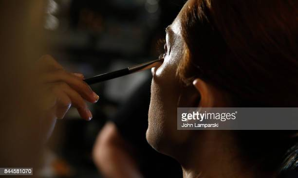 A model prepare bakcstage during the Jeremy Scott collection during the September 2017 New York Fashion Week The Shows on September 8 2017 in New...