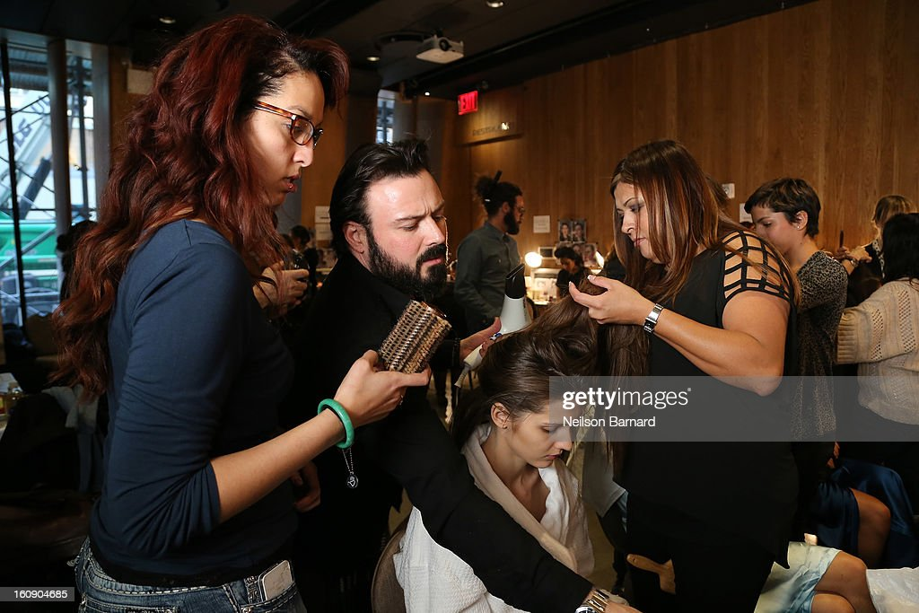 Model prepare with Rodney Cutler, Redken Expert and celebrity runway stylist for THE SALON at Ulta Beauty Backstage, at the La Perla Fall 2013 Presentation on February 7, 2013 in New York City.