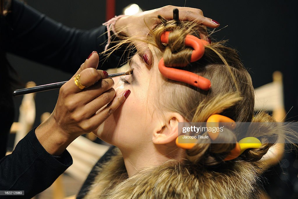 A model prepares at the Francesco Scognamiglio show during Milan Fashion Week Womenswear Fall/Winter 2013/14 on February 20, 2013 in Milan, Italy.