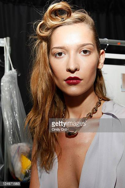 A model prepares at the Juan Carlos Obando Spring 2012 presentation during Mercedes Benz Fashion Week at The Box at Lincoln Center on September 14...