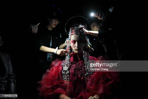 Model prepares backstaage for the FENGSANSAN Fashion show during China Fashion Week on October 28, 2019 in Beijing, China.