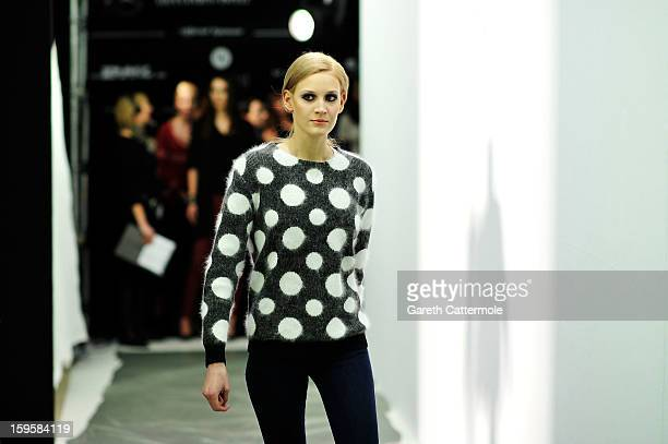 A model prepares backstage ahead of the Agne Kuzmickaite Igrida Zabere Kaetlin Kaljuvee Autumn/Winter 2013/14 fashion show during MercedesBenz...