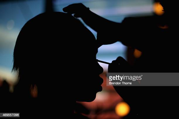 A model prepares backstage ahead of the AJE show at MercedesBenz Fashion Week Australia 2015 at Carriageworks on April 13 2015 in Sydney Australia