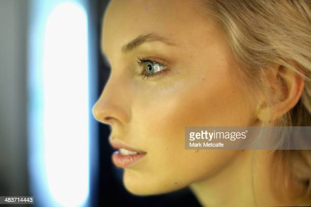 A model prepares backstage ahead of the Aje show at MercedesBenz Fashion Week Australia 2014 at Carriageworks on April 10 2014 in Sydney Australia