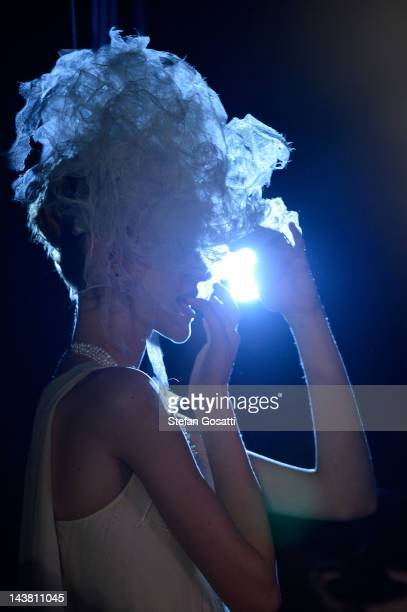 A model prepares backstage ahead of the Akira show on day five of MercedesBenz Fashion Week Australia Spring/Summer 2012/13 at the Overseas Passenger...