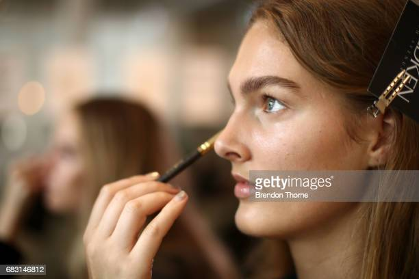 A model prepares backstage ahead of the Albus Lumen show at MercedesBenz Fashion Week Resort 18 Collections at La Porte Deux on May 15 2017 in Sydney...