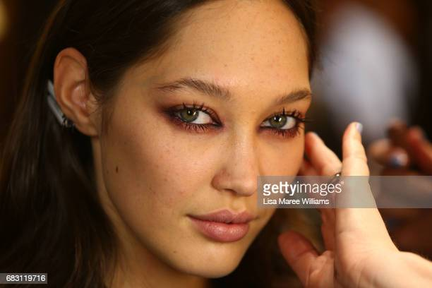 A model prepares backstage ahead of the Alice McCall show at MercedesBenz Fashion Week Resort 18 Collections at Carriageworks on May 15 2017 in...