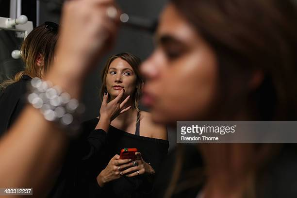 A model prepares backstage ahead of the Cameo show at MercedesBenz Fashion Week Australia 2014 at Carriageworks on April 8 2014 in Sydney Australia