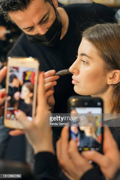 Model prepares backstage ahead of the Cihan Nacar Lookbook for Istanbul Fashion Week on April 15, 2021 in Istanbul, Turkey.