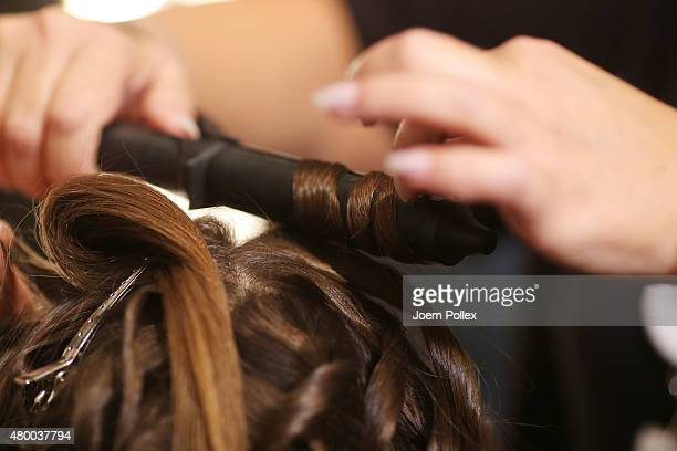 Model prepares backstage ahead of the Dimitri show during the Mercedes-Benz Fashion Week Berlin Spring/Summer 2016 at Brandenburg Gate on July 9,...